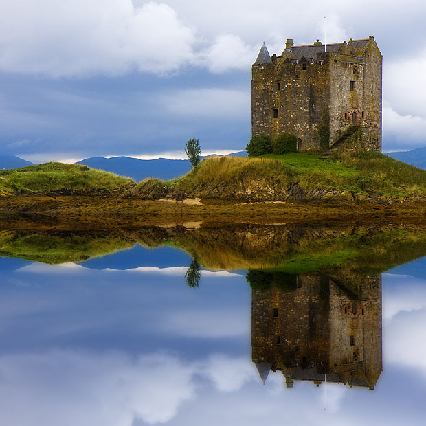 Castle reflected in water