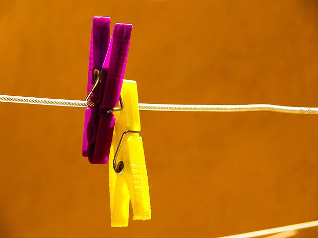 Two colourful pegs on a line