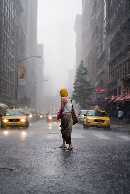 Woman crossing New York road in the rain