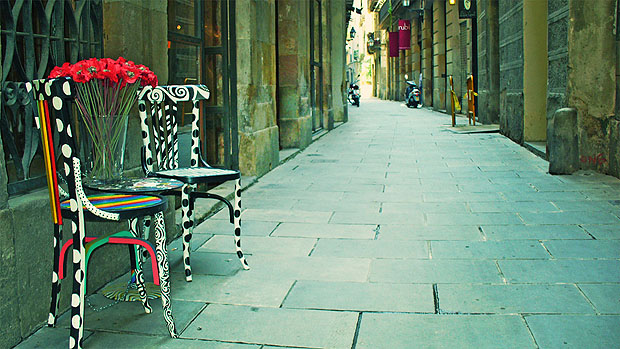 Two chairs in an empty Barcelona street