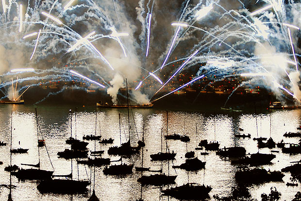 Fireworks reflected in a harbour full of boats