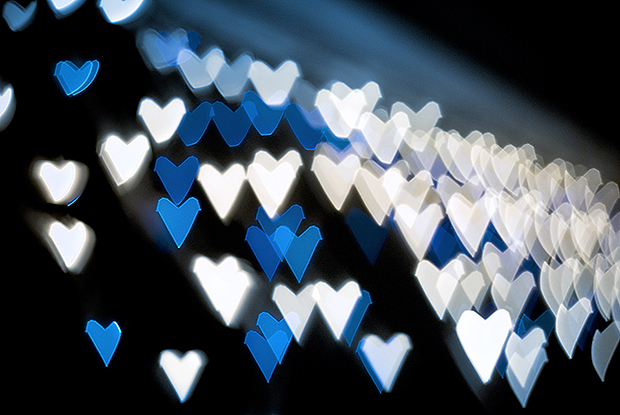 Blue and white heart shaped blurry lights