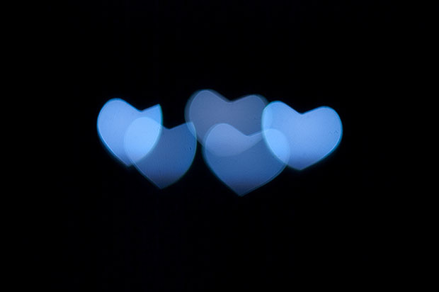 Blue heart bokeh on black