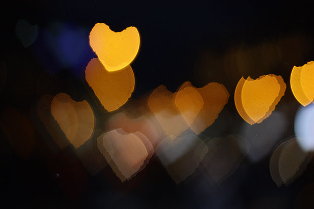 Blurry night lights shaped like hearts