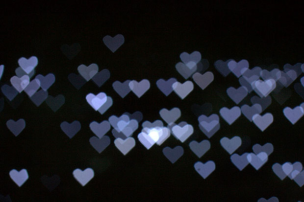 Blue heart bokeh on a black background