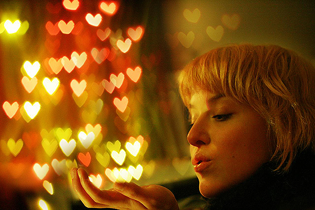 Woman in front of heart shaped bokeh