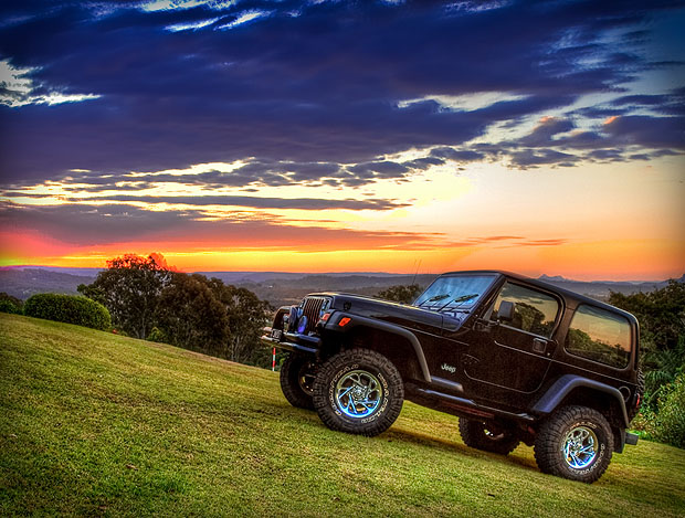 Jeep on a hill against the sunset
