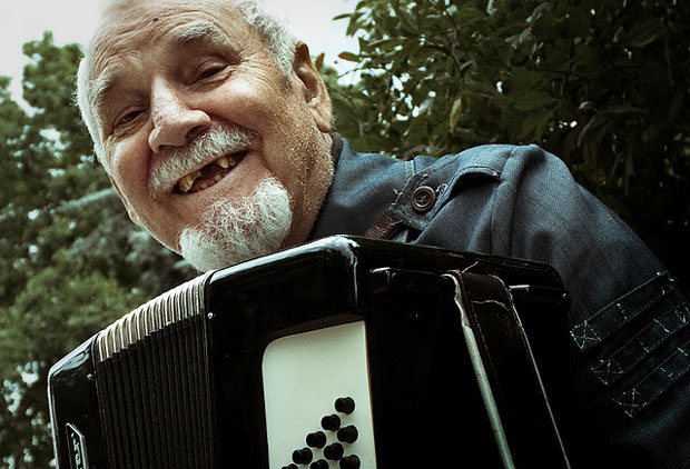 Old man playing the accordion