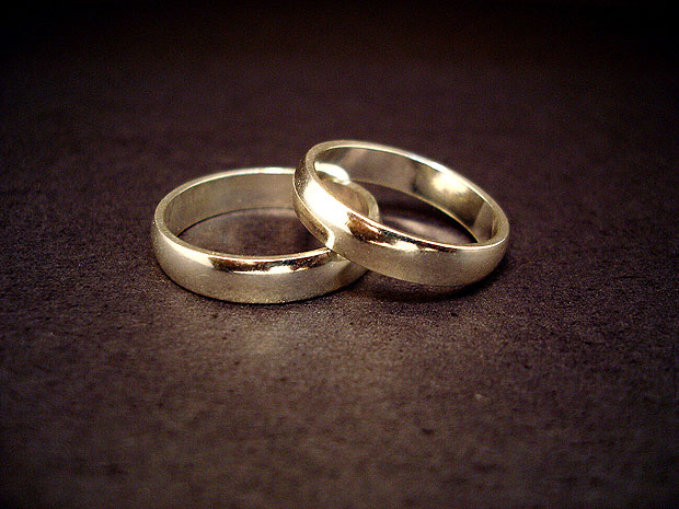 Pair of gold rings on a dark surface