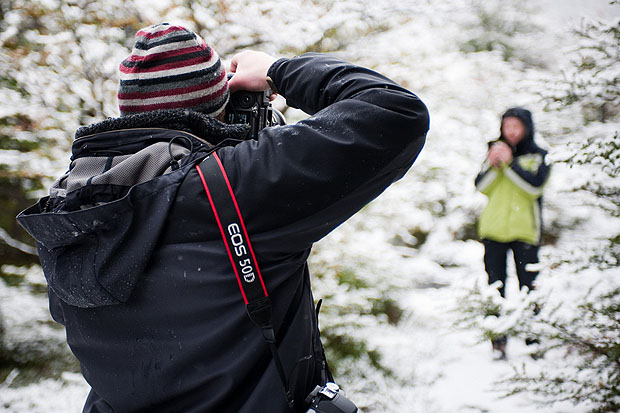 A photographer in the snow
