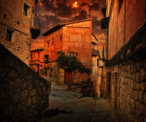 Spanish street at sunset, framed with buildings