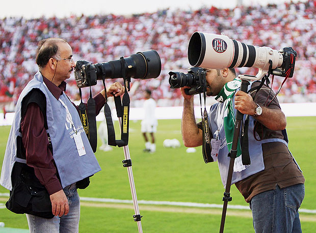 Sports photographers with monopods