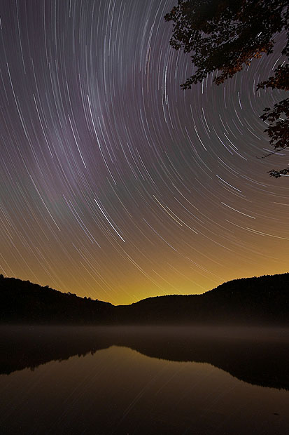 Star trails reflected in a lake