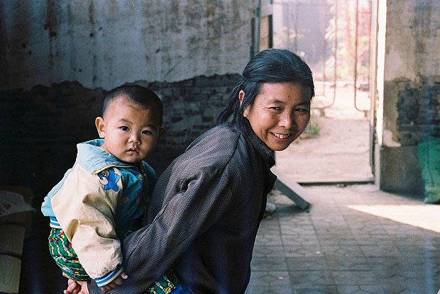 Chinese woman carrying her grandson