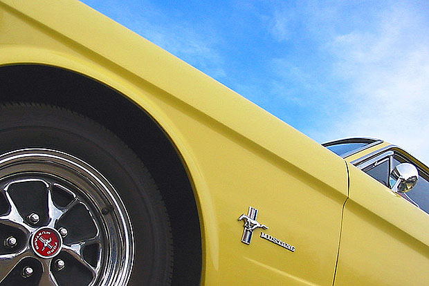 Looking up at a yellow Ford Mustang